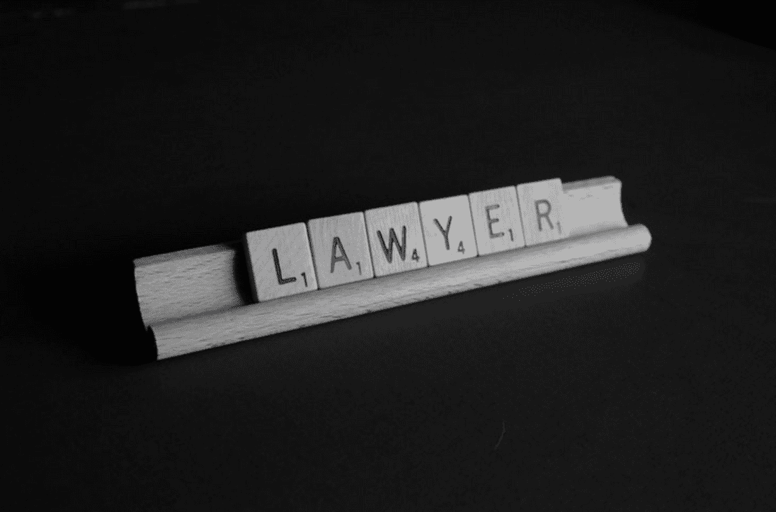 Scrabble pieces spelling out lawyer
